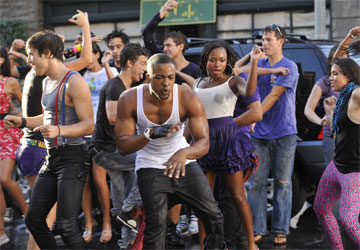 PAUL McGILL(left), COLLINS PENNIE (center) and NATURI NAUGHTON (right) perform in the music video for the theme song from Fame, in theaters September 25, 2009.